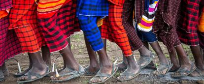 Tanzanian Maasai doing a traditional dance forming a long line of colour.